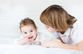 Cute brother and baby sister playing together his little Royalty Free Stock Photos