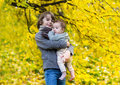 Cute brother and his baby sister in autumn park little walking a beautiful Royalty Free Stock Image