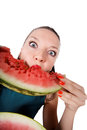 Cute brunette girl eating fresh watermelon Stock Photos