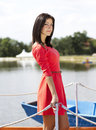 Cute brunette girl on a lake pontoon Royalty Free Stock Photography
