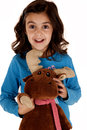 Cute brunette girl posing holding stuffed reindeer a Royalty Free Stock Photo
