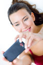 Cute brunette woman taking photo of herself Stock Photos