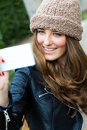 Cute brunette woman taking photo of herself portrait on the street Stock Photo
