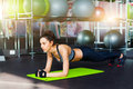 Cute brunette working out at a gym Royalty Free Stock Photo