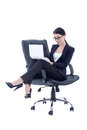 Cute business woman sitting on chair and working with laptop iso Stock Image