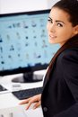 Cute business woman sitting in front of computer Stock Image