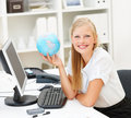 Cute business woman with a world globe Royalty Free Stock Photos