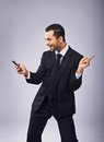 Cute businessman dancing out of joy young with phone Stock Photo