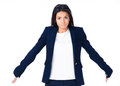Cute businesswoman shrugging her shoulders Royalty Free Stock Photo