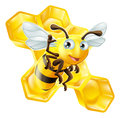 Cute cartoon bee and honeycomb a mascot waving in front of honey comb Stock Photo