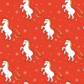 Cute cartoon christmas seamless vector pattern background illustration with unicorn with santa hat and snowflakes Royalty Free Stock Photo