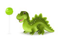 Cute cartoon dinosaur dragon character with green lollypop. Vector illustration. Royalty Free Stock Photo