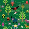 Cute cartoon monsters seamless pattern on green e background vector illustration Stock Photos