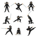 Cute cartoon ninja vector illustration. Kicking and jumping ninjas isolated on white background Royalty Free Stock Photo