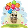 Owl in the box is flying on balloons