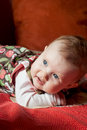 Cute caucasian baby girl little lying on her stomach Royalty Free Stock Image