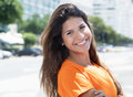 Cute caucasian woman in a orange shirt in the city Royalty Free Stock Photo