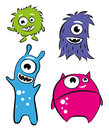 Cute characters monsters four or aliens Royalty Free Stock Photography
