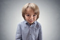 Cute cheeky boy with guilty expression Royalty Free Stock Photo