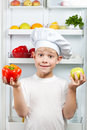 Cute Chef near the open refrigerator Royalty Free Stock Photo