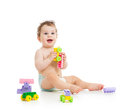 Cute child boy playing with toys construction set over white background Stock Image