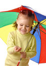Cute child catching raindrops under umbrella Royalty Free Stock Image