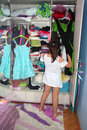 A cute child choosing dress in her wardrobe Stock Photography