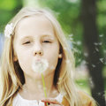 Cute child and dandelion on greenery background Royalty Free Stock Image