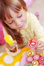 Cute child eating candies Stock Images