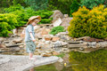Cute child fishing by the pond in the beautiful garden Stock Photography