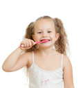 Cute child girl brushing teeth isolated Stock Photos