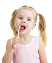 Cute child girl brushing teeth isolated white background Royalty Free Stock Photos