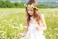Cute child girl in green field Royalty Free Stock Photo