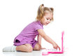 Cute child girl playing with pink laptop toy Stock Photos