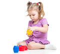 Cute child girl playing with toy Stock Photos