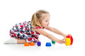 Cute child girl playing with toys over white Royalty Free Stock Image