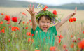 Red haired beautiful girl in poppy field