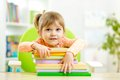 Cute child girl preschooler with books indoor Royalty Free Stock Image
