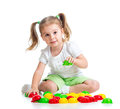Cute child playing with mosaic toy Royalty Free Stock Image