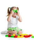 Cute child playing with mosaic toy Royalty Free Stock Images
