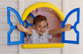 Cute child playing in toy house Stock Photos