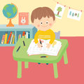 Cute child in school classroom sitting at desk and writing.
