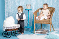 Cute children with baby carriage happy family concept Royalty Free Stock Image