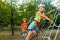 Cute children. Boy and girl climbing in a rope Royalty Free Stock Photo