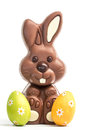 Cute chocolate bunny two easter eggs white background Stock Images