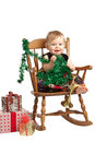 Cute Christmas baby rocks in patchwork dress Royalty Free Stock Image