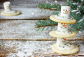 Cute Christmas cookies snowman for winter holidays on snowy wood Royalty Free Stock Photo