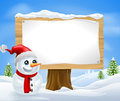 Cute Christmas Snowman and Sign Stock Images