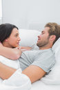Cute couple awaking and looking at each other in bed Royalty Free Stock Photo