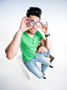 Cute couple dressed casual making funny faces view from above wide angle shot pretty Royalty Free Stock Photos